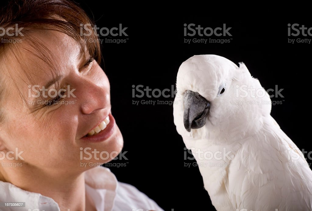 Woman Holding a Cockatoo stock photo
