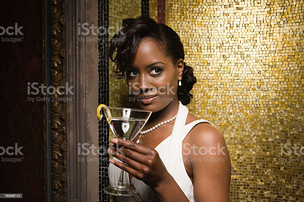 A woman holding a cocktail 免版稅 stock photo