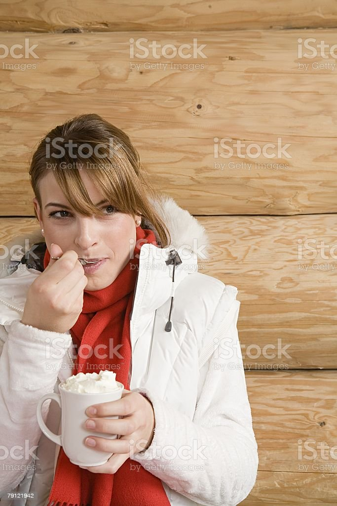 Woman holding a cup of hot chocolate royalty-free stock photo
