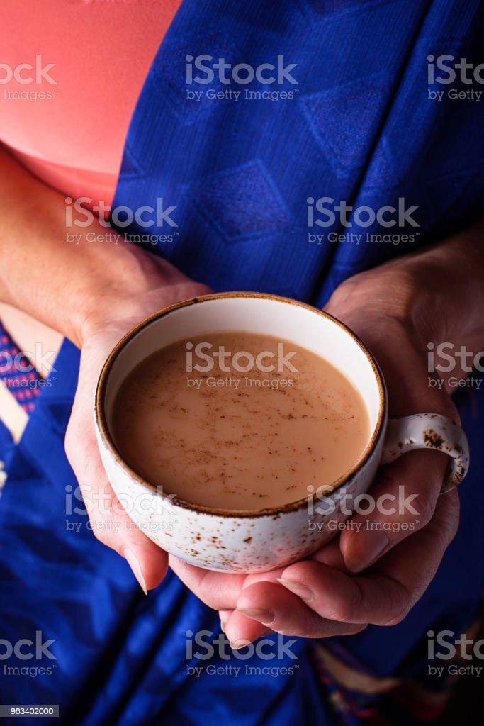 Woman  holding a cup of masala  tea - Zbiór zdjęć royalty-free (Anyż)