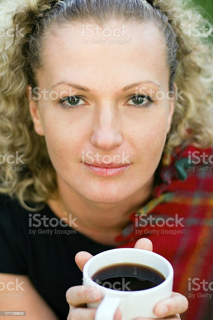 woman holding a cup royalty-free stock photo