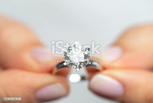 Woman showing a diamond ring.