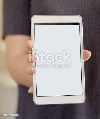 863476202istockphoto Woman holding a digital tablet with blank white screen. 1091555688