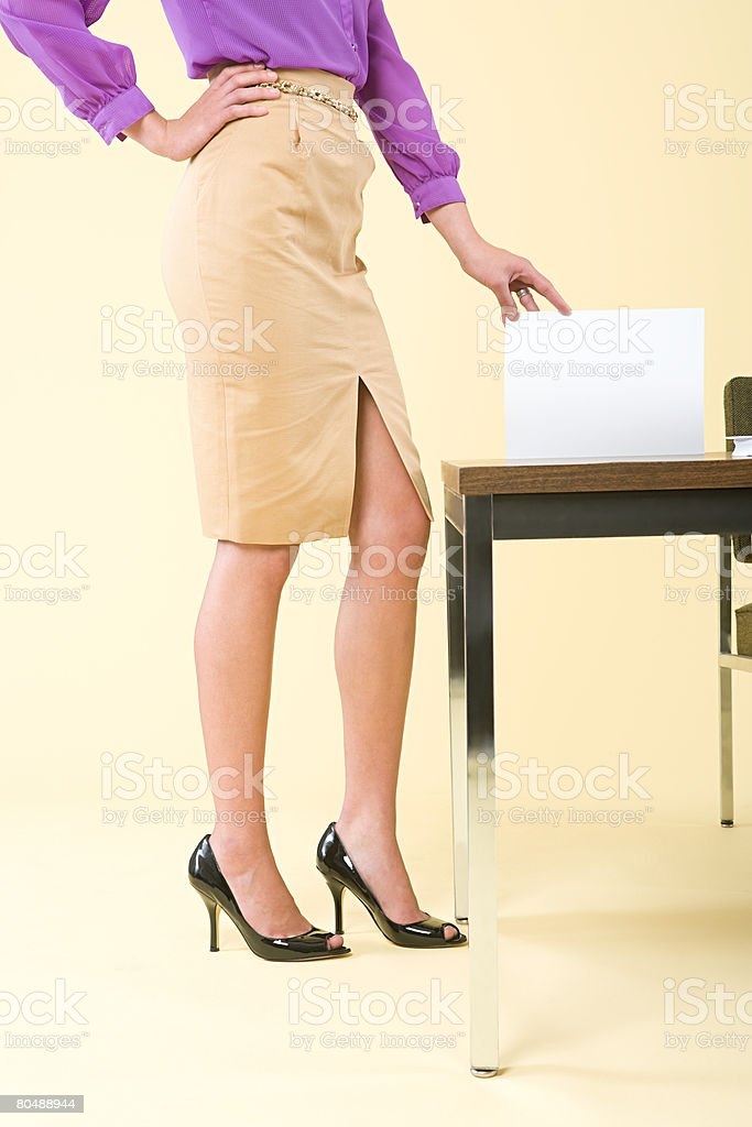A woman holding a document 免版稅 stock photo