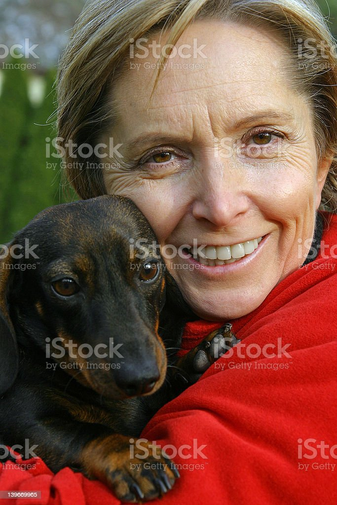 woman holding a dog royalty-free stock photo