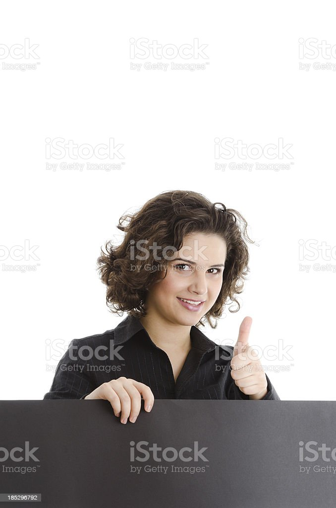Woman holding a empty board, with approval thumb up royalty-free stock photo