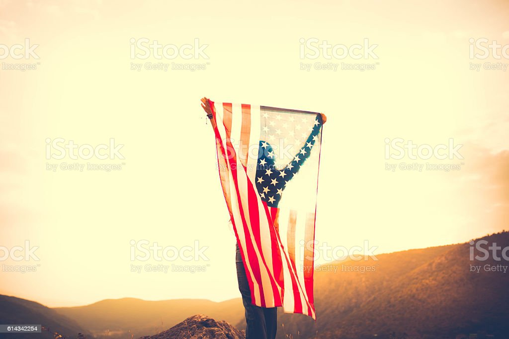 Woman holding a flag stock photo
