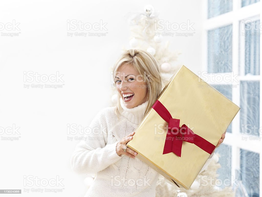 Woman holding a Gift royalty-free stock photo