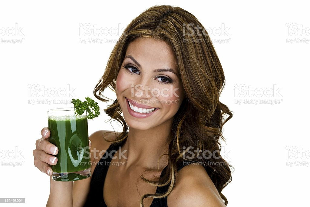Woman holding a glass of green juice royalty-free stock photo