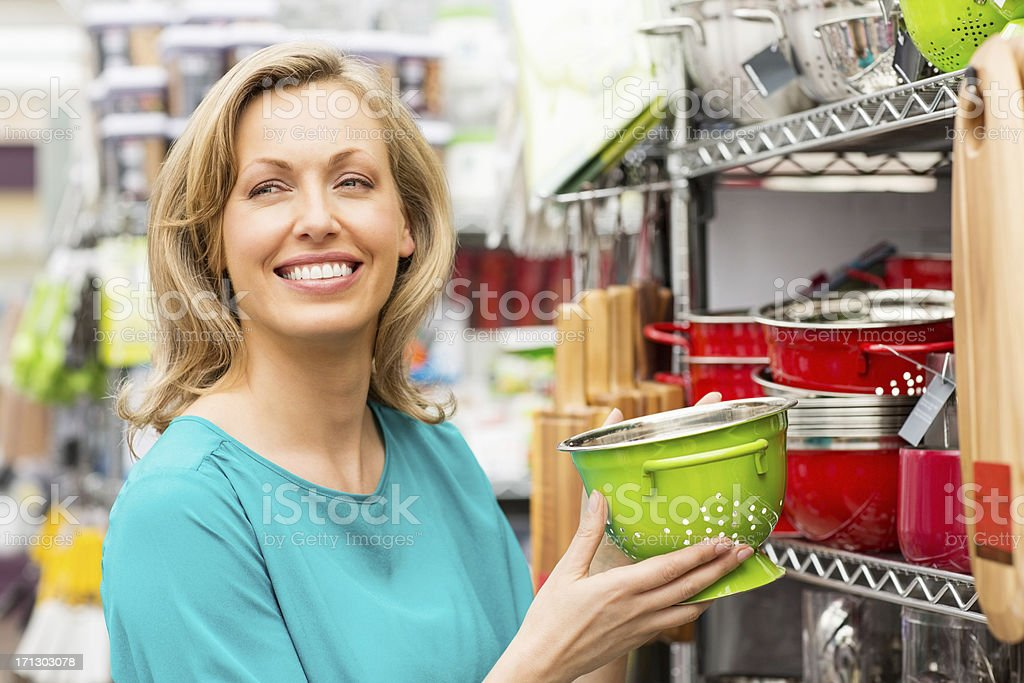 Woman Holding a Green Enamel Colander royalty-free stock photo