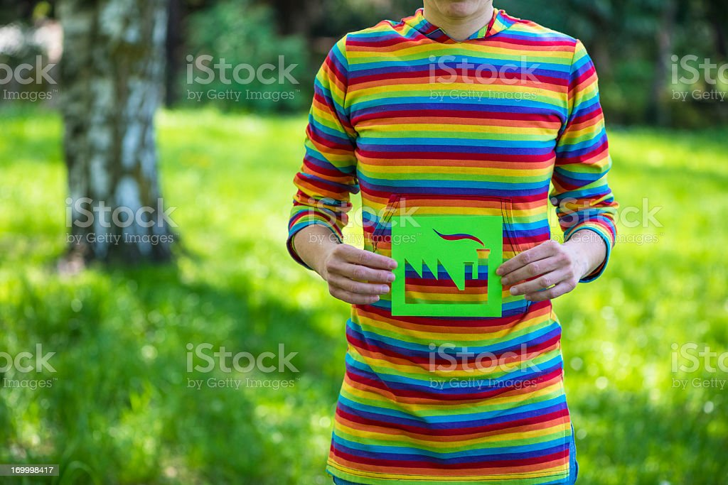 Woman holding a green factory - environmental conservation royalty-free stock photo