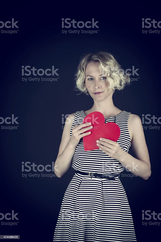 Woman holding a heart stock photo