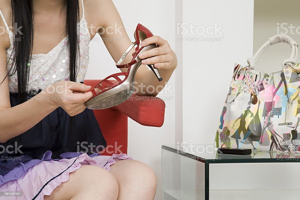 Woman holding a high heeled shoe 免版稅 stock photo