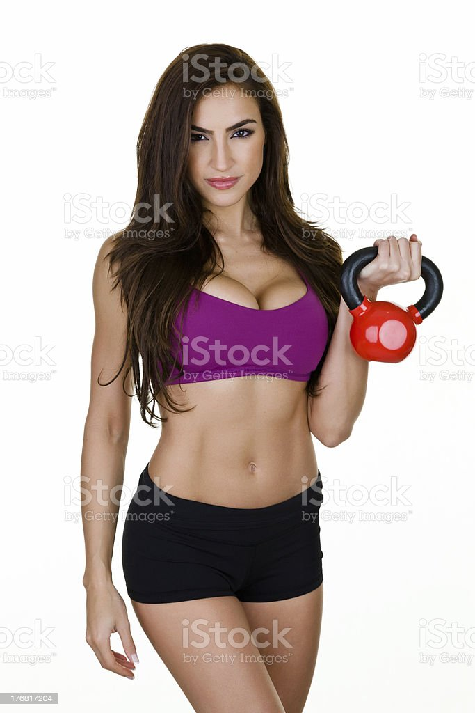 Woman holding a kettle bell royalty-free stock photo