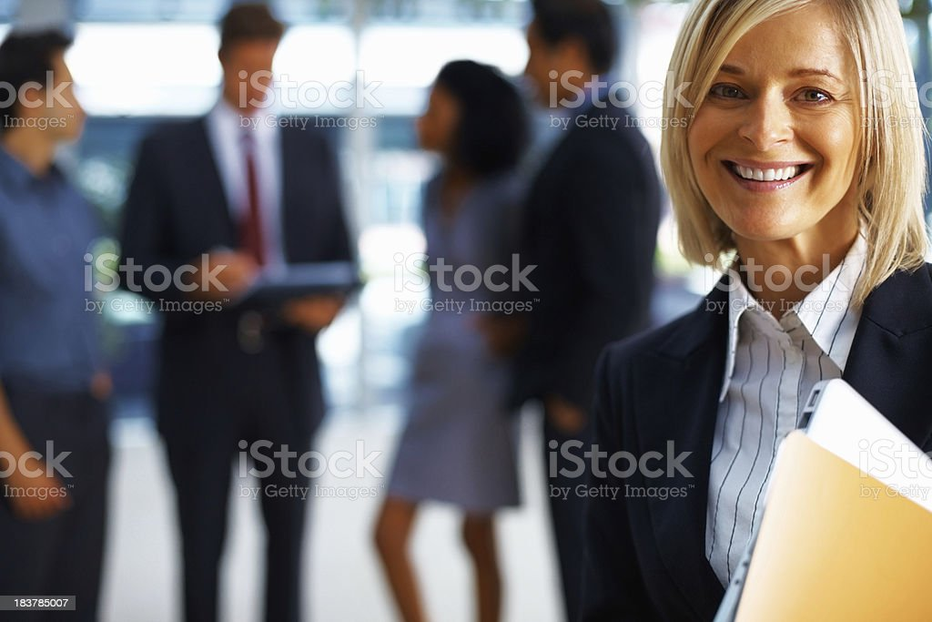 Woman holding a laptop at workplace royalty-free stock photo