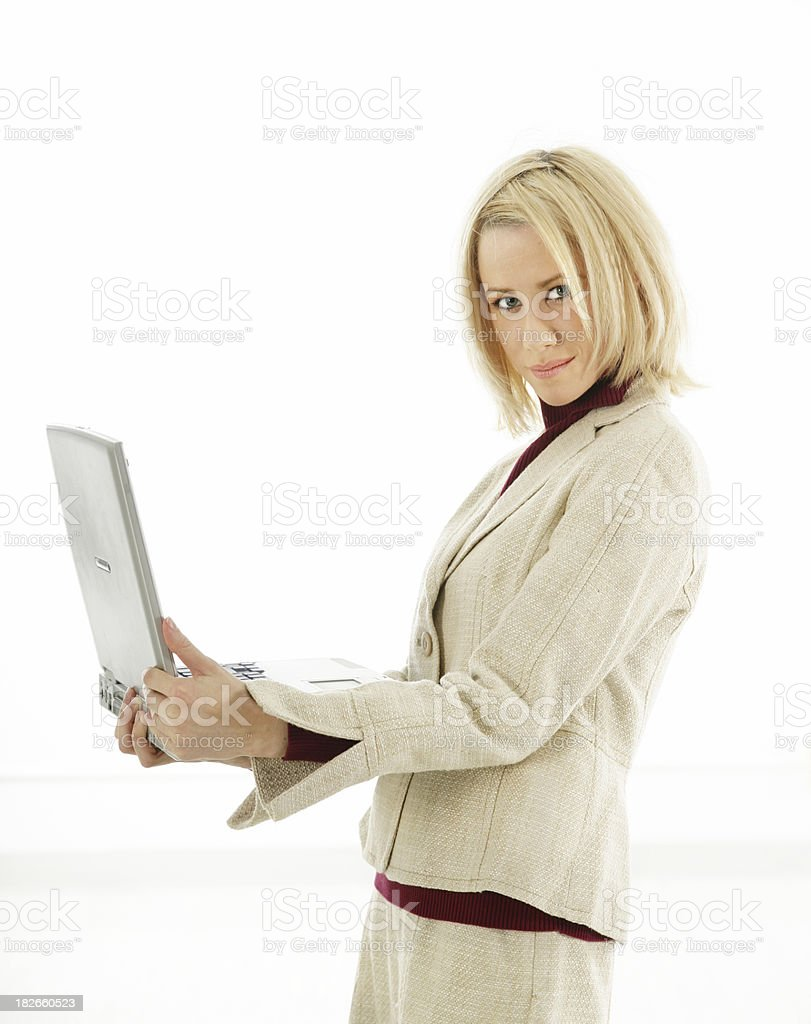 Woman holding a laptop royalty-free stock photo