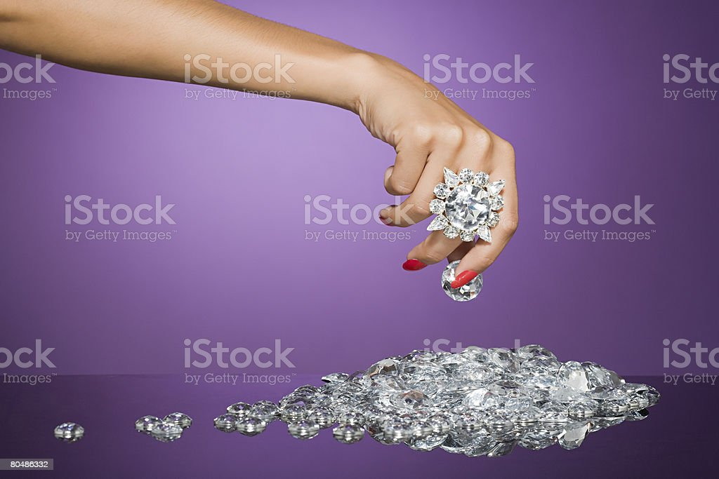 Woman holding a large diamond royalty-free 스톡 사진
