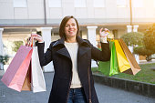 Woman holding a lot of shopper bags during shopping time