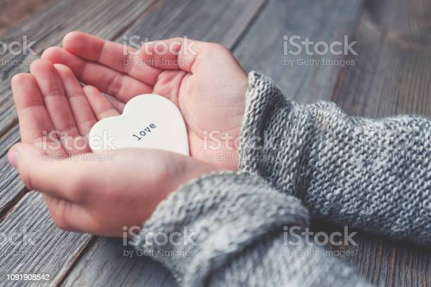 Woman holding a love heart with the word love on it picture id1091908542?b=1&k=6&m=1091908542&s=612x612&h=p  uvmsxwi guxwpvhd5uca0nqusea o9ryxemln5dy=