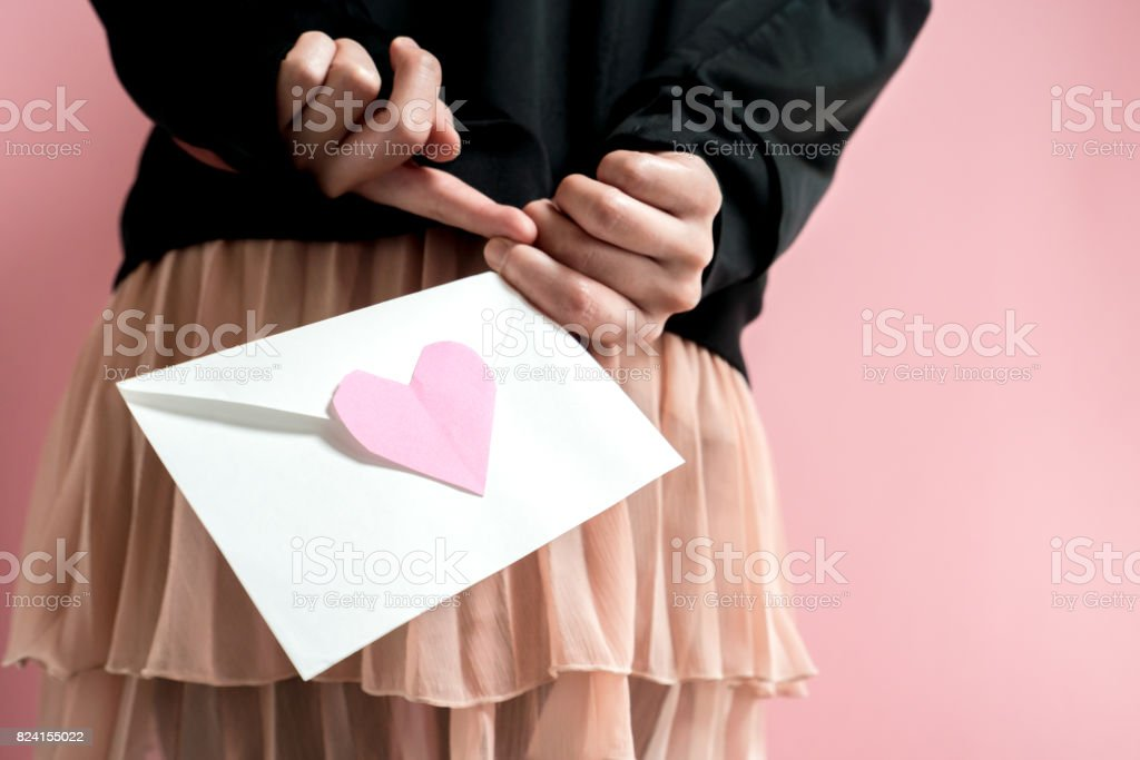 Woman holding a love letter stock photo