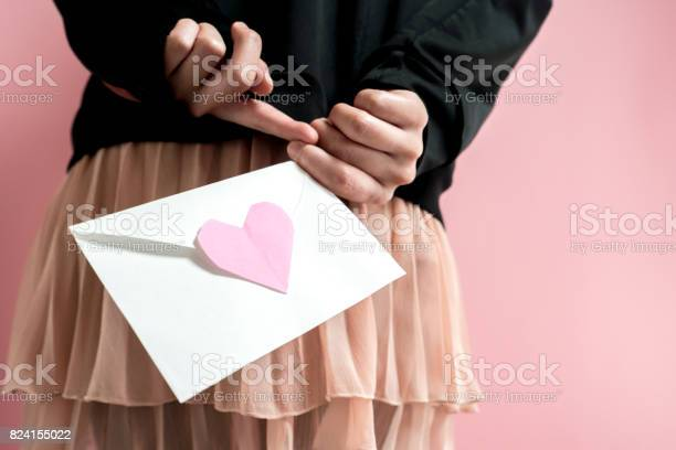 Woman holding a love letter.