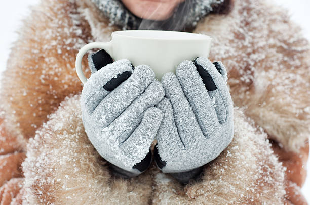 woman holding a mug - sports glove stock photos and pictures