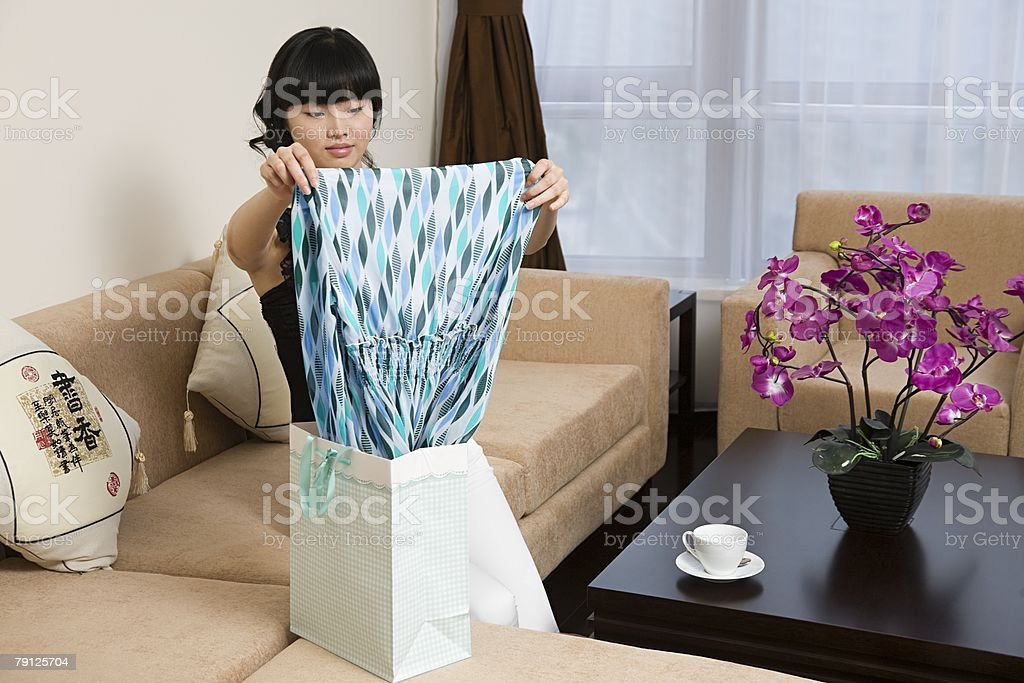 Woman holding a new dress Lizenzfreies stock-foto