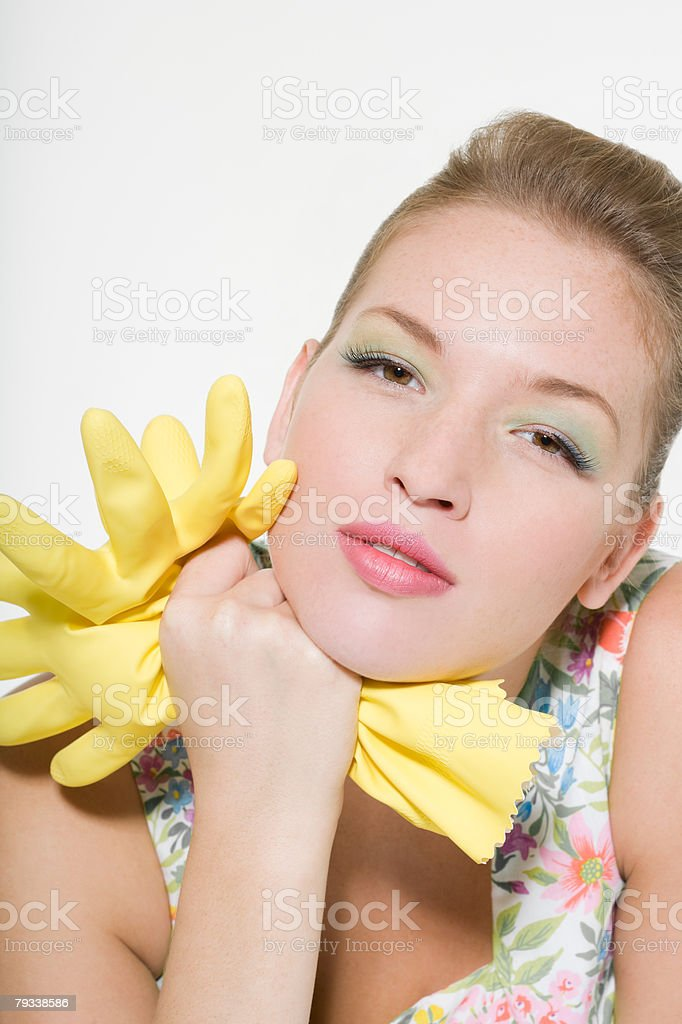 Woman holding a pair of rubber gloves royalty-free stock photo