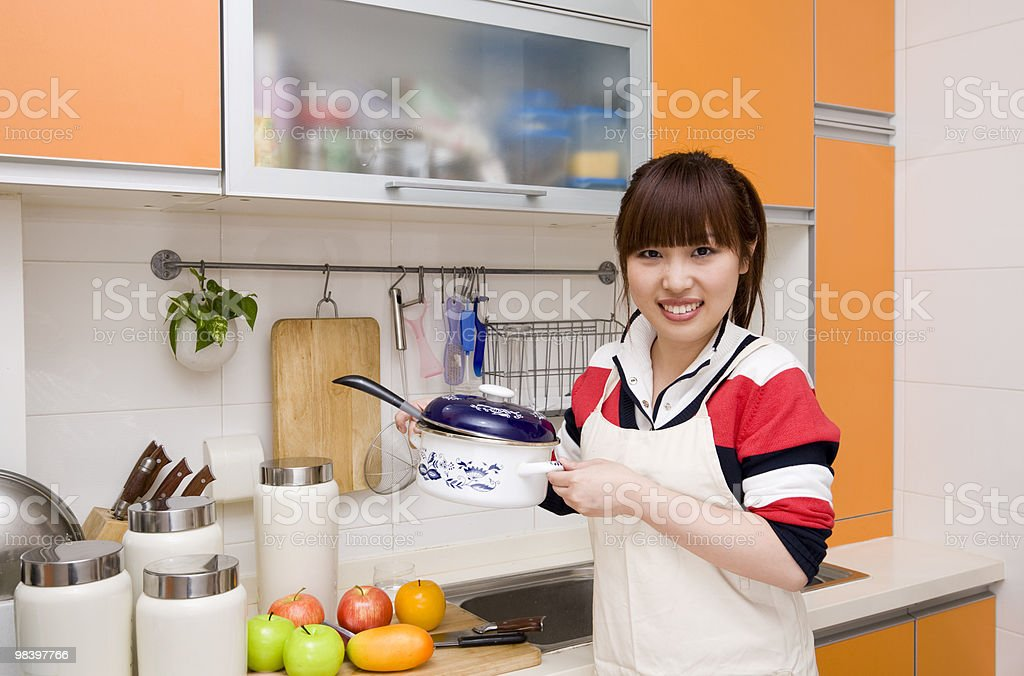 woman holding a pan in kitchen royalty-free stock photo