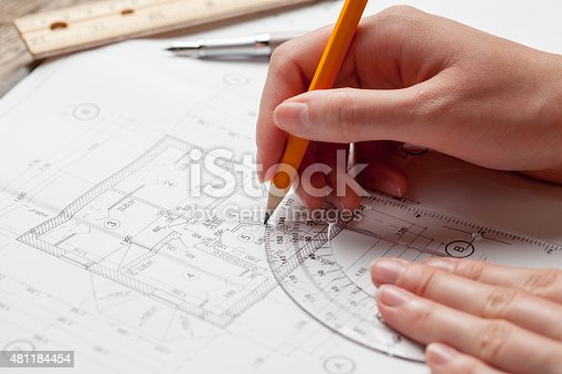 536971177 istock photo woman holding a pen over a house constructing plan 481184454