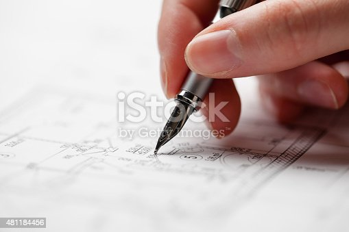 536971177 istock photo woman holding a pen over a house constructing plan 481184456