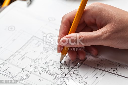 536971177 istock photo woman holding a pen over a house constructing plan 481184464