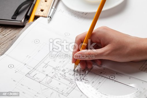 536971177 istock photo woman holding a pen over a house constructing plan 481186882
