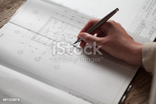 536971177 istock photo woman holding a pen over a house constructing plan 481203878