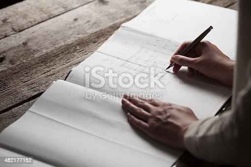 536971177 istock photo woman holding a pen over a house constructing plan 482177152