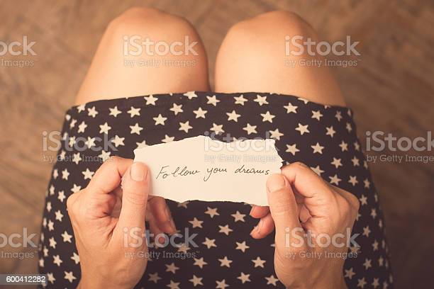 Woman holding a piece of paper with a message picture id600412282?b=1&k=6&m=600412282&s=612x612&h=zgvgnrjlqrd7nkuc4l 2rbzy8bim9whkg9iowqg6vse=