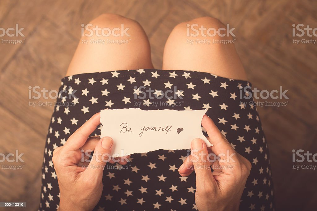 Woman holding a piece of paper with a message stock photo