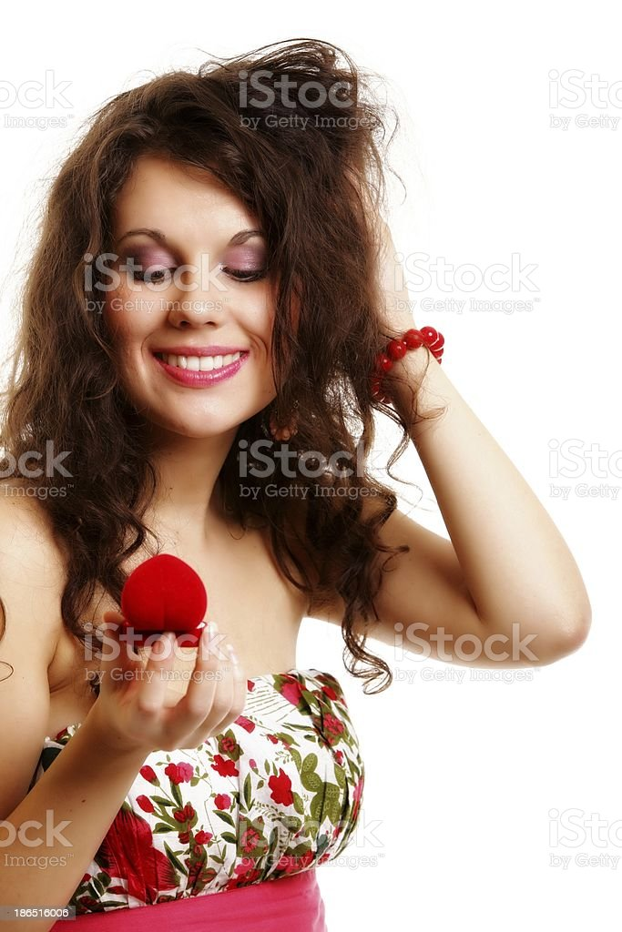 woman holding a present with engagement ring royalty-free stock photo