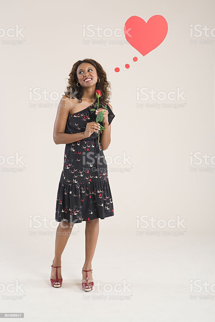 A woman holding a rose royalty-free stock photo