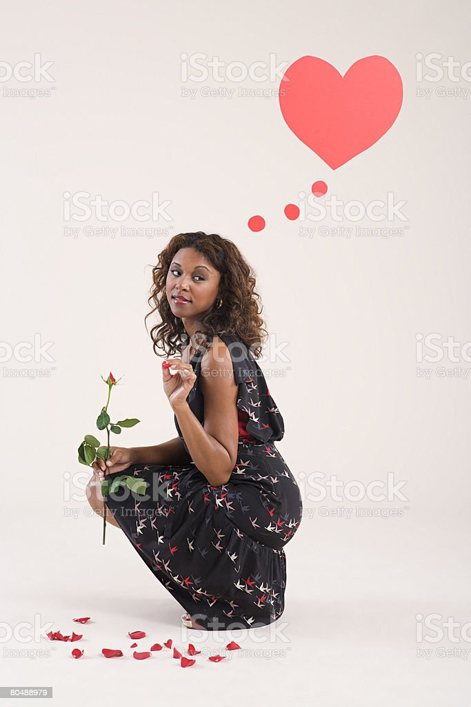 A woman holding a rose royalty-free 스톡 사진