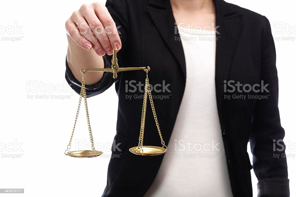 woman holding a scales of justice stock photo