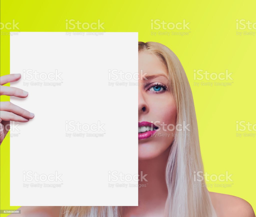 Woman holding a sheet of paper stock photo