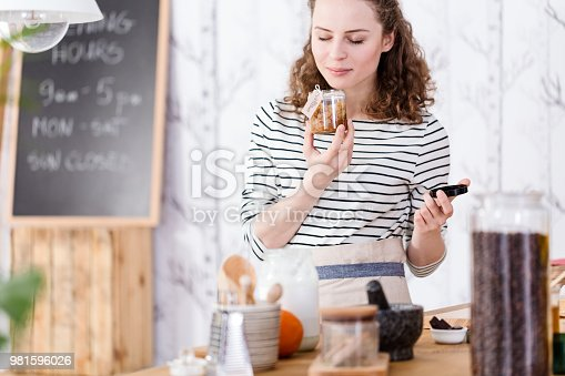 istock Woman holding a skincare product 981596026