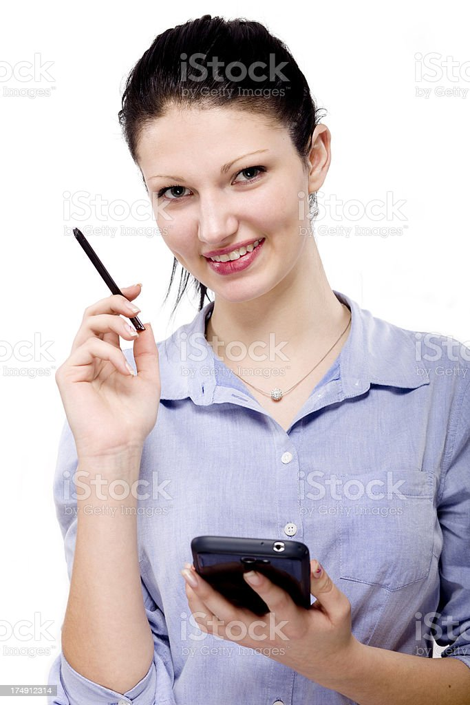 woman holding a smartphone and pen royalty-free stock photo