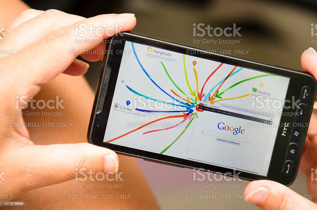 Woman holding a smartphone with Google+ interactive tour royalty-free stock photo