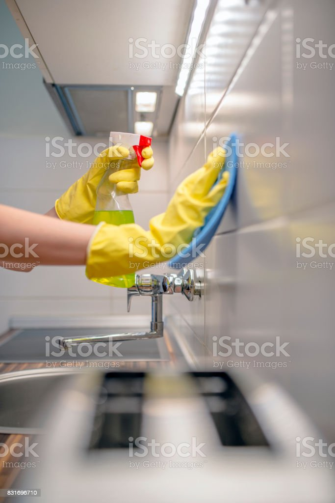House cleaning - Close up photo of woman washes ceramic tiles on...