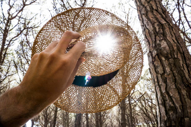 Woman holding a straw hat stock photo