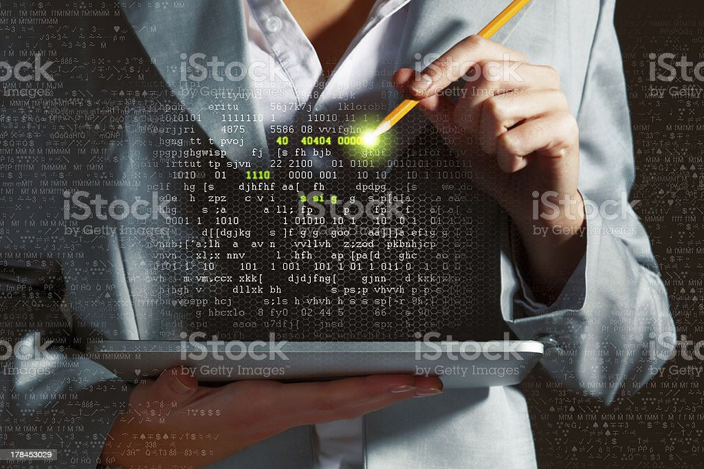 A woman holding a tablet pressing random strings of numbers - Royalty-free Abstract Stock Photo