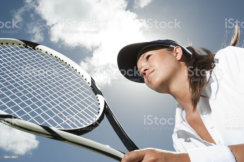 Woman holding a tennis racquet royalty-free stock photo