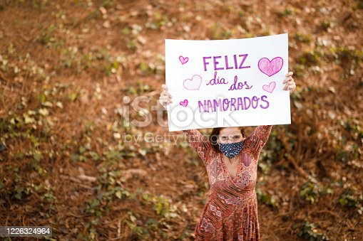 Woman holding a valentine's day poster.